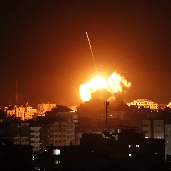 A ball of fire lights the sky above buildings in Gaza on March 25, 2019. (Credit: MAHMUD HAMS/AFP/Getty Images)