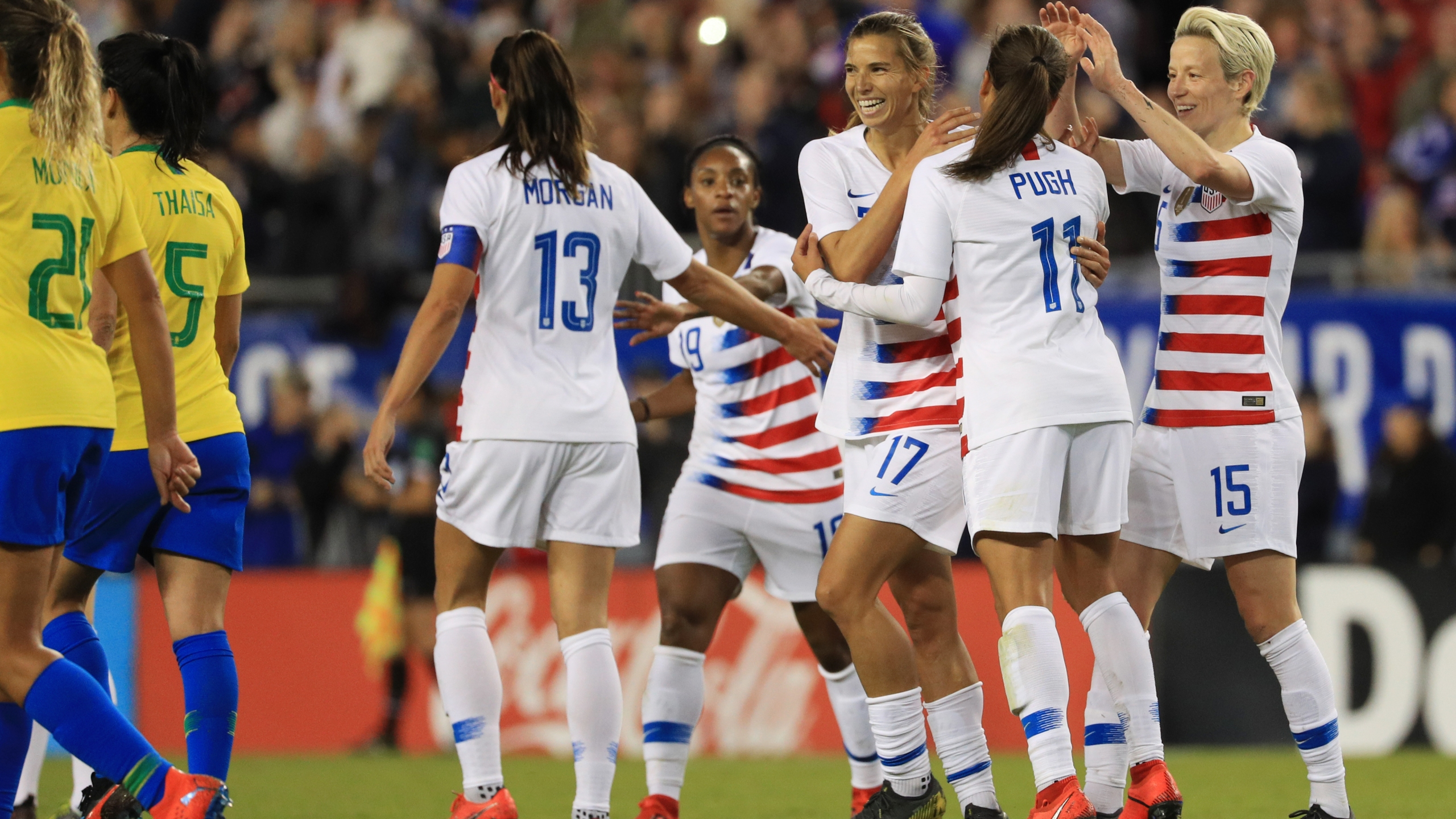 """Megan Rapinoe, Mallory Pugh and Alex Morgan celebrate with Tobin Heath after a goal against Brazil in the first half of the """"She Believes Cup"""" at Raymond James Stadium on March 5, 2019, in Tampa, Florida. (Credit: Mike Ehrmann/Getty Images)"""