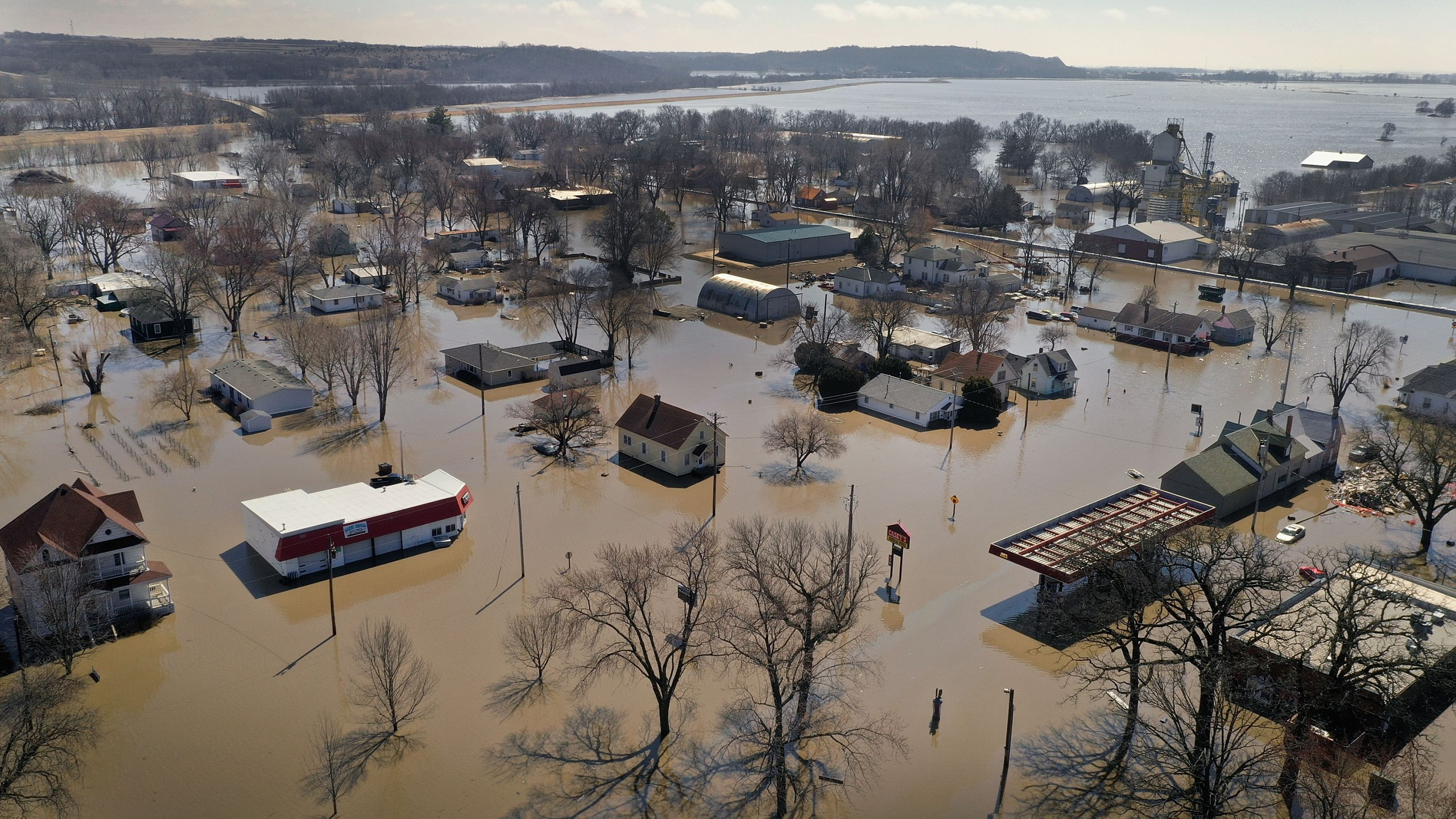 Homes and businesses are surrounded by floodwater on March 20, 2019 in Hamburg, Iowa. (Credit: Scott Olson/Getty Images)