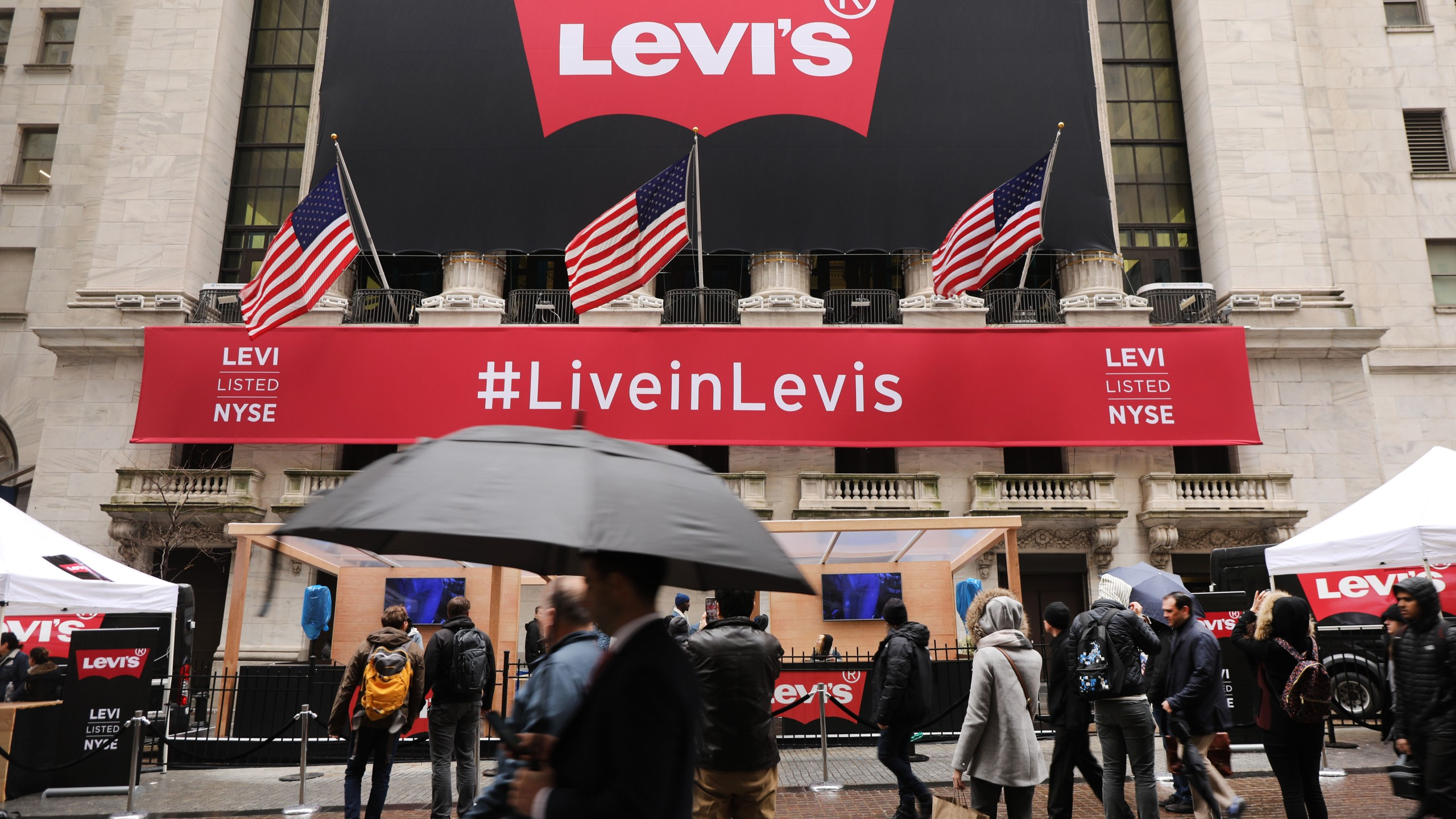 A Levi's banner hangs from the New York Stock Exchange on the day that Levi Strauss has returned to the stock market with an IPO on March 21, 2019 in New York City. (Credit: Spencer Platt/Getty Images)