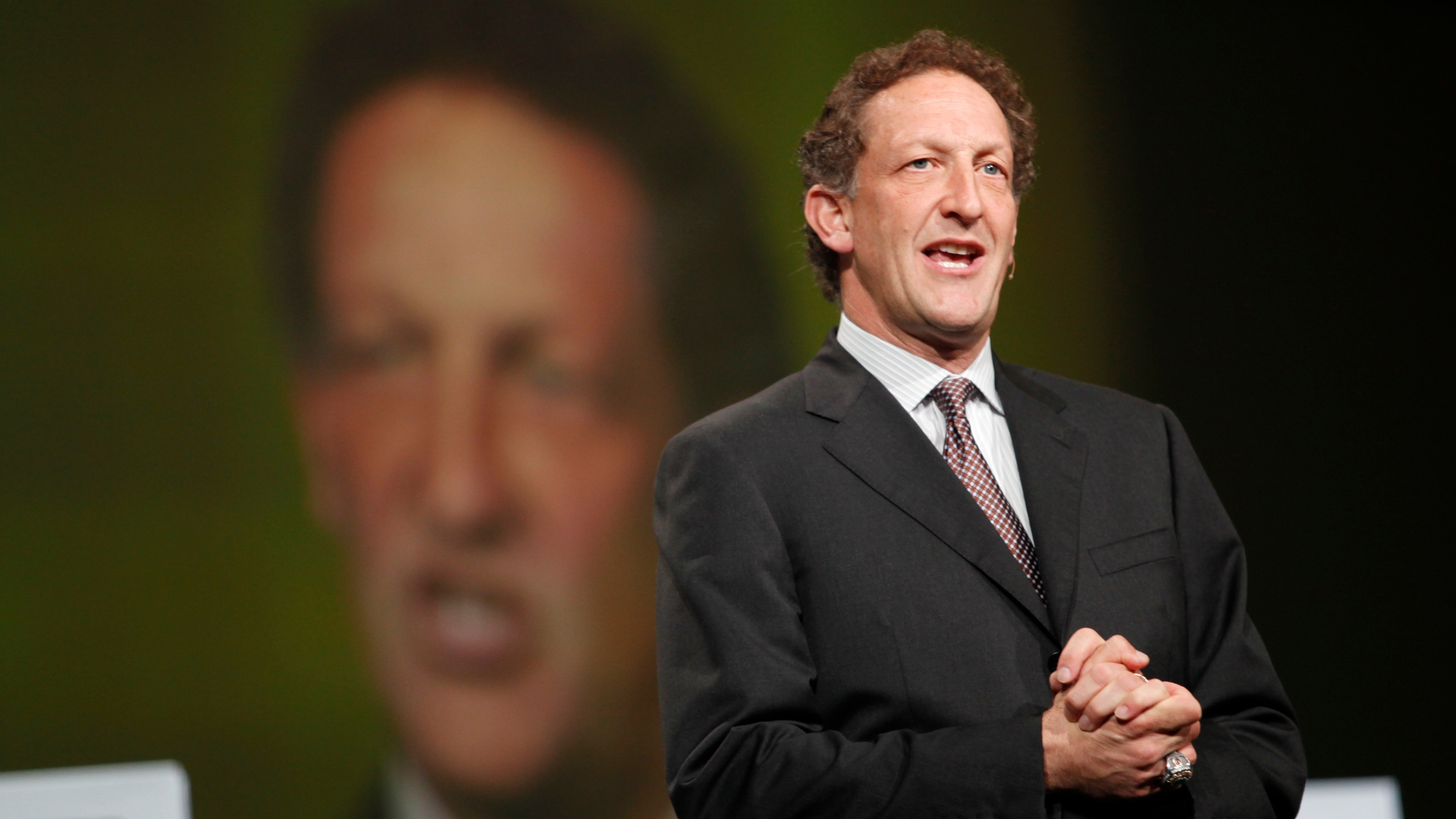 San Francisco Giants President Larry Baer appears to the stage to award Oracle CEO Larry Ellison the 2010 World Series ring at the Moscone Center in San Francisco during the Oracle OpenWorld 2011 on October 2, 2011. (Credit: KIMIHIRO HOSHINO/AFP/Getty Images)
