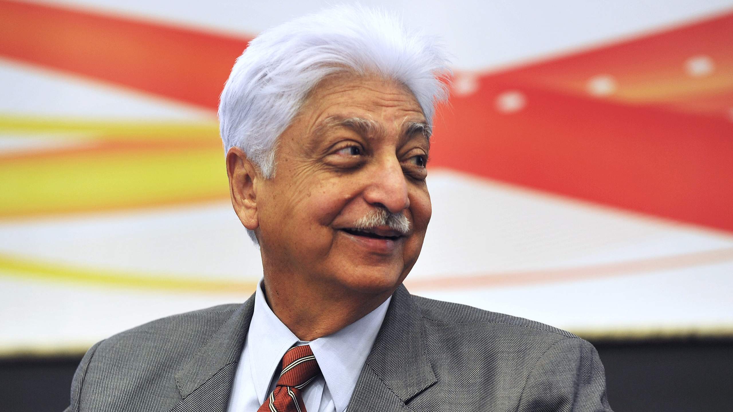 Indian Chairman of Wipro Limited, Azim Premji, smiles during a press conference held to announce the company's 2nd quarter results in Bangalore on November 2, 2012. (Credit: Manjunath Kiran/AFP/Getty Images)