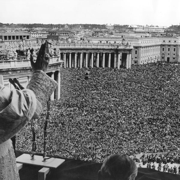 Pope Pius XII blessing the vast crowd gathered in St Peter's Square to witness his appearance on the Vatican balcony. (Credit: Fox Photos/Getty Images)