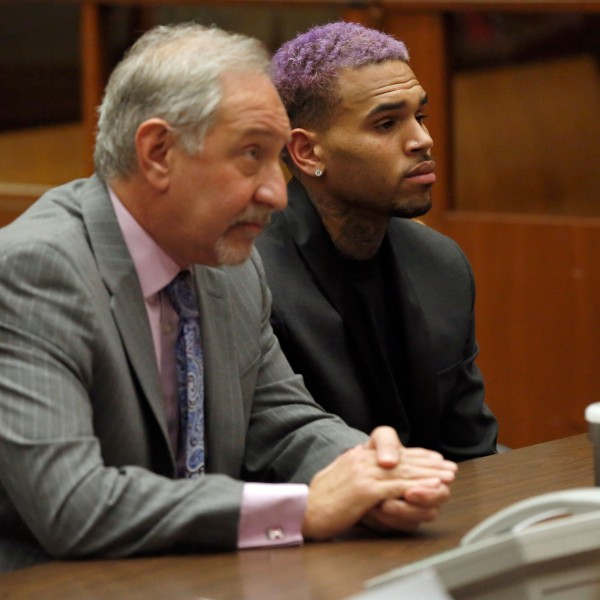 Singer Chris Brown and his lawyer Mark Geragos attend a progress hearing at Los Angeles Superior Court on March 20, 2015. (Credit: Mario Anzuoni-Pool/Getty Images)