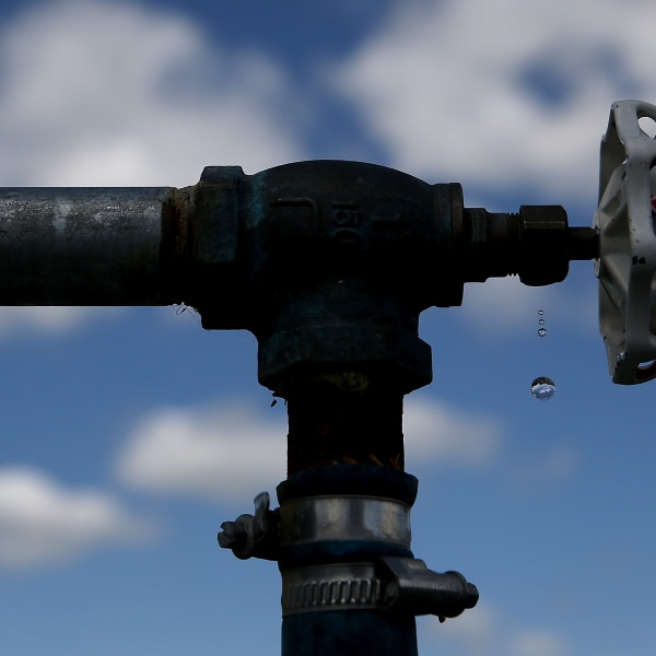 Water drips from a faucet at the Dublin San Ramon Services District residential recycled water fill station in Pleasanton on April 8, 2015. (Credit: Justin Sullivan / Getty Images)