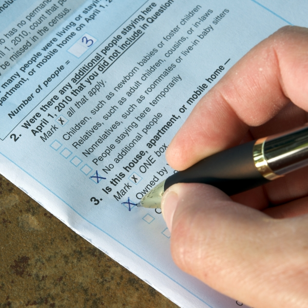 A person fills out a census form in this file photo. (Credit: Getty Images)
