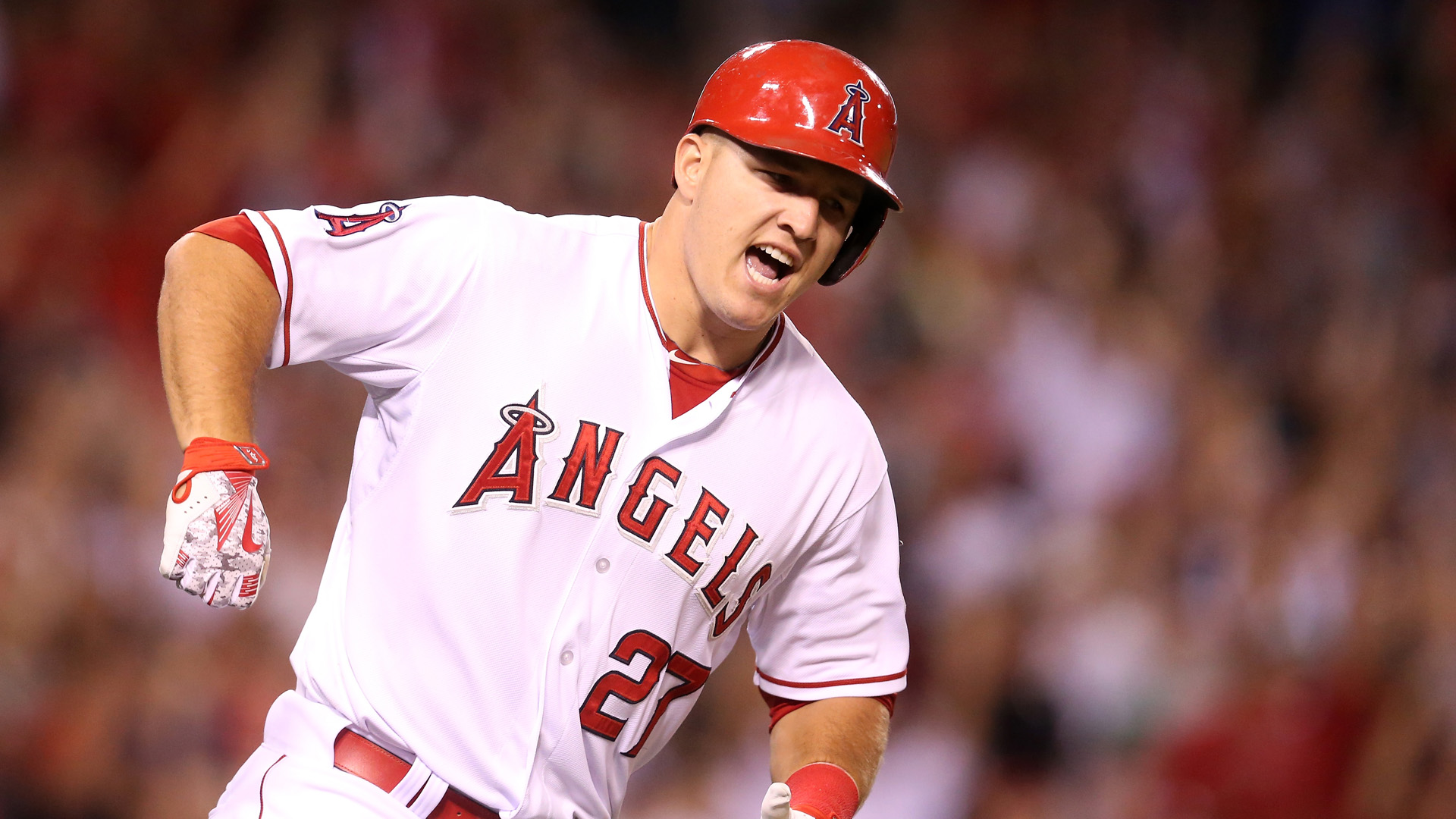 Mike Trout reacts as he runs to first as his walk off home run clears the wall in the ninth inning against the Boston Red Sox at Angel Stadium of Anaheim on July 17, 2015 in Anaheim, California. (Credit: Stephen Dunn/Getty Images)