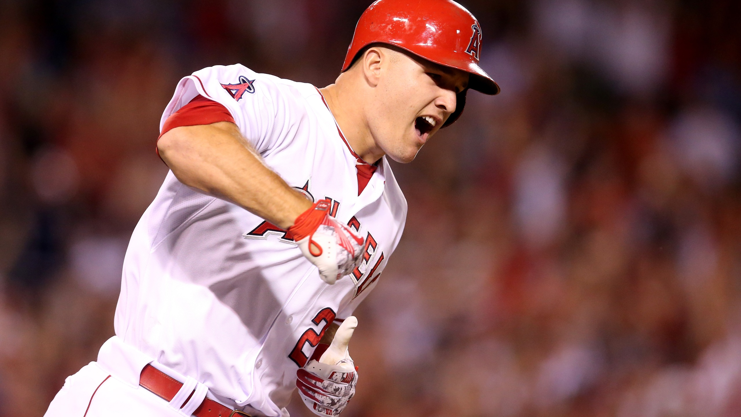 Mike Trout #27 of the Los Angeles Angels of Anaheim reacts as he runs to first as his walk off home run clears the wall in the ninth inning against the Boston Red Sox at Angel Stadium of Anaheim on July 17, 2015 in Anaheim, California. (Credit: Stephen Dunn/Getty Images)