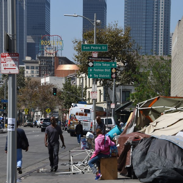 Los Angeles financial district skyscrapers are seen behind a tent encampment on Sep. 23, 2015, in downtown Los Angeles. (Credit: Robyn Beck/AFP/Getty Images)