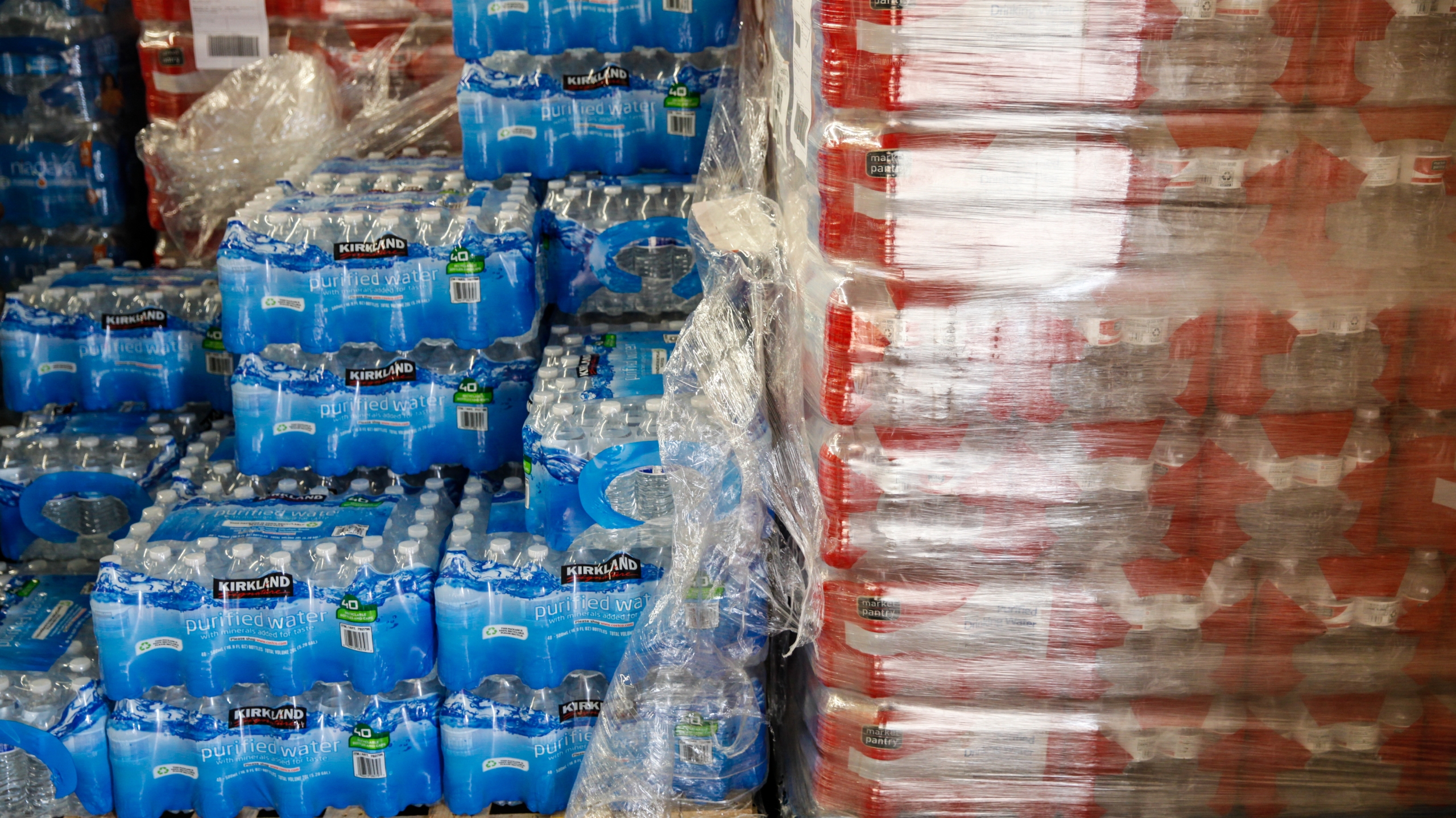 Cases of bottled water are shown at a fire station on February 7, 2016 in Flint, Michigan. (Credit: Sarah Rice/Getty Images)