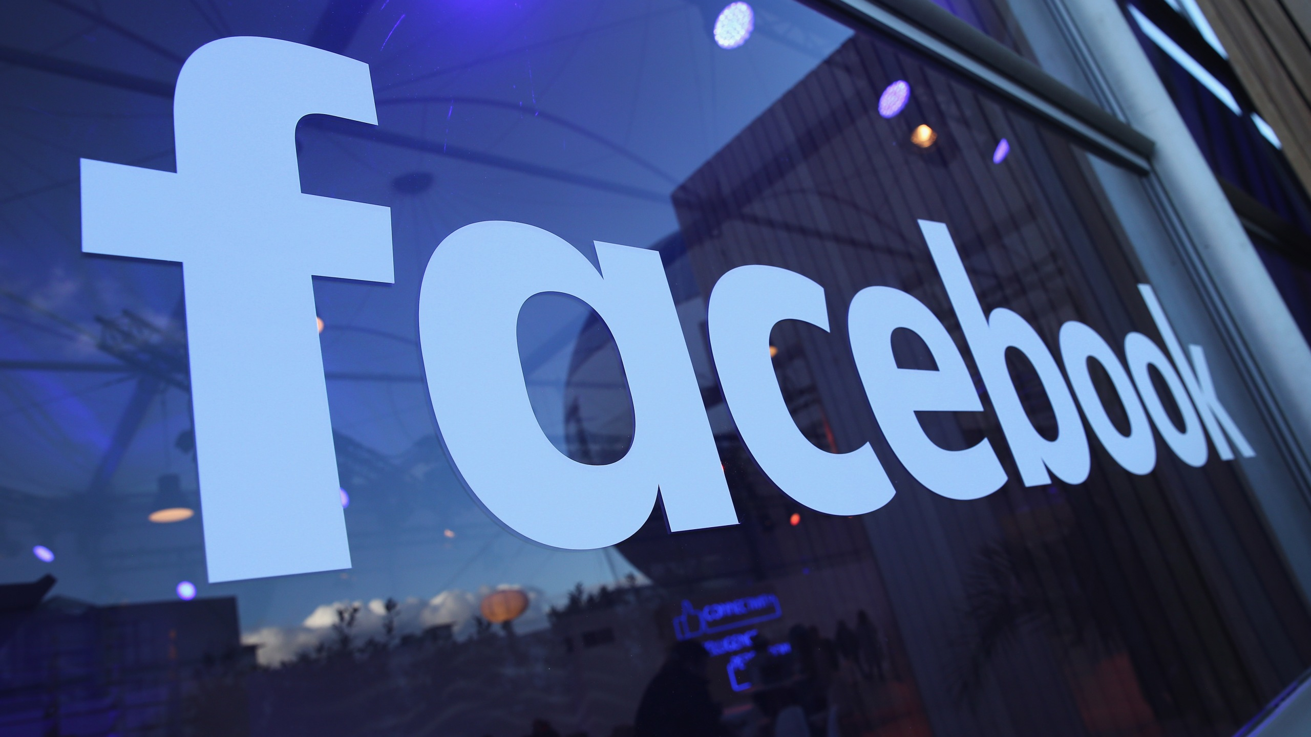 The Facebook logo is displayed at the Facebook Innovation Hub on February 24, 2016 in Berlin, Germany. (Credit: Sean Gallup/Getty Images)