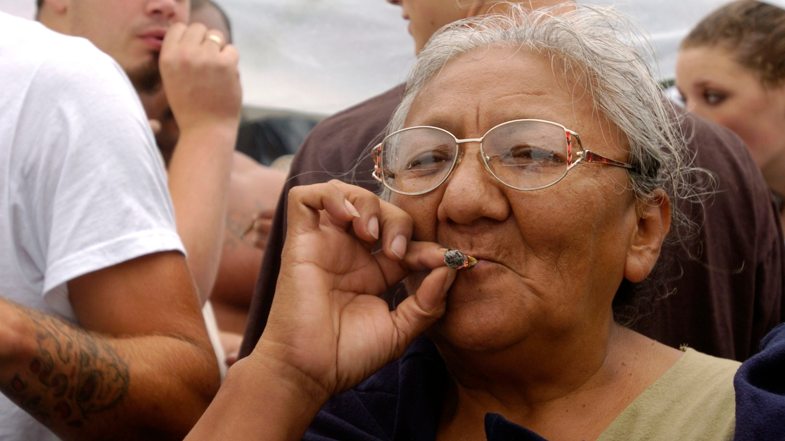 A woman smokes a marijuana joint at Hempfest on Aug. 21, 2004, in Seattle, Washington. (Credit: Ron Wurzer/Getty Images)
