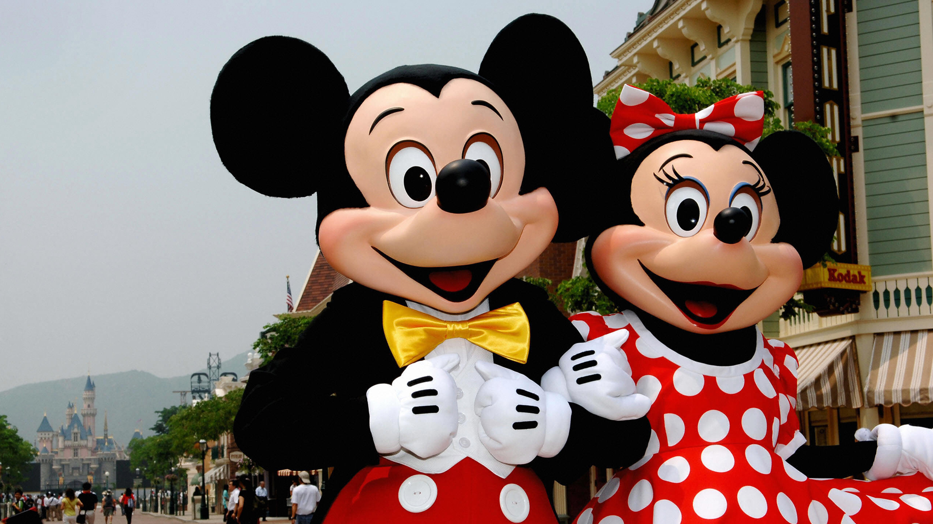 Mickey and Minnie Mouse walk around Main Street in Hong Kong Disneyland on Sep. 11, 2005. (Credit: ANDREW ROSS/AFP/Getty Images)
