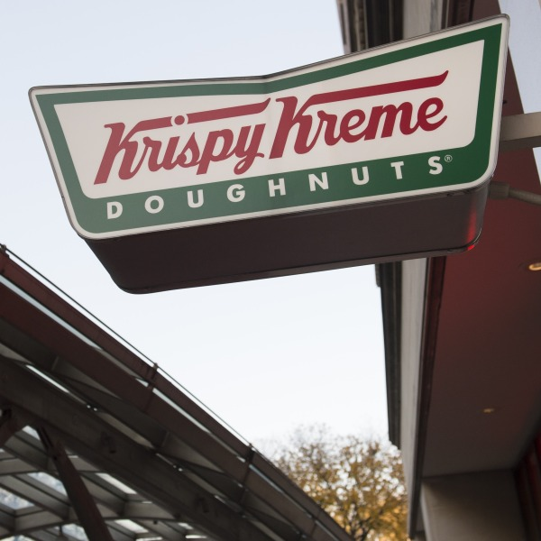 A sign for Krispy Kreme doughnuts is seen outside their store in Washington, DC, December 1, 2016. (Credit: SAUL LOEB/AFP/Getty Images)