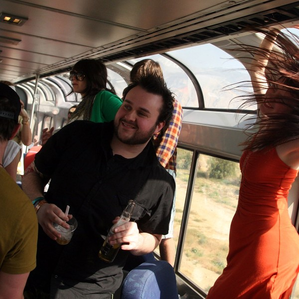 Festivalgoers ride the Coachella Express train to the Coachella Valley Music and Arts Festival in Indio on April 24, 2008. (Credit: Matt Simmons / Getty Images)