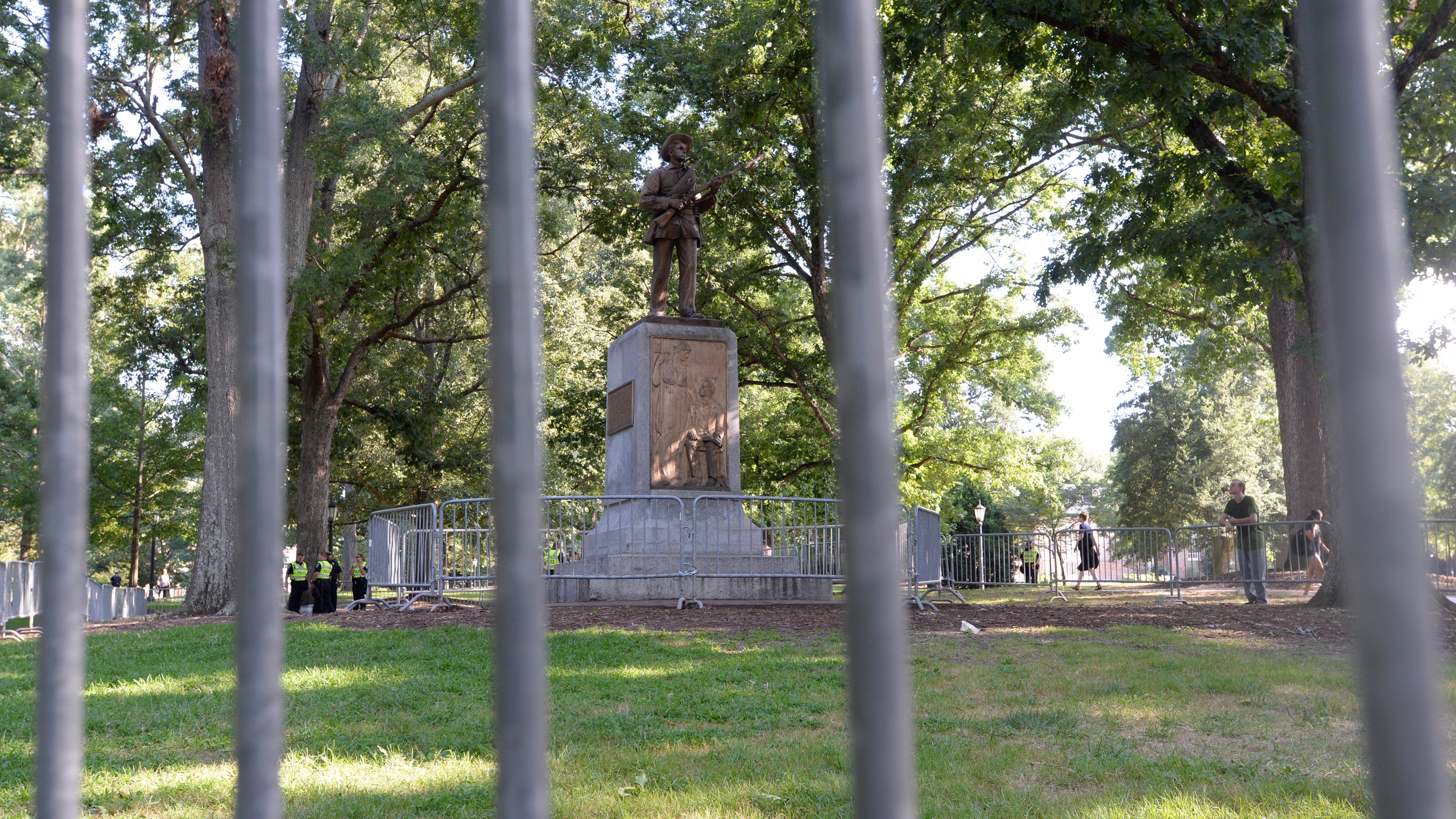 A Confederate statue, coined Silent Sam, is guarded by two layers of fence, chain and police on the campus of the University of North Carolina at Chapel Hill on Aug. 22, 2017. (Credit: Sara D. Davis / Getty Images)