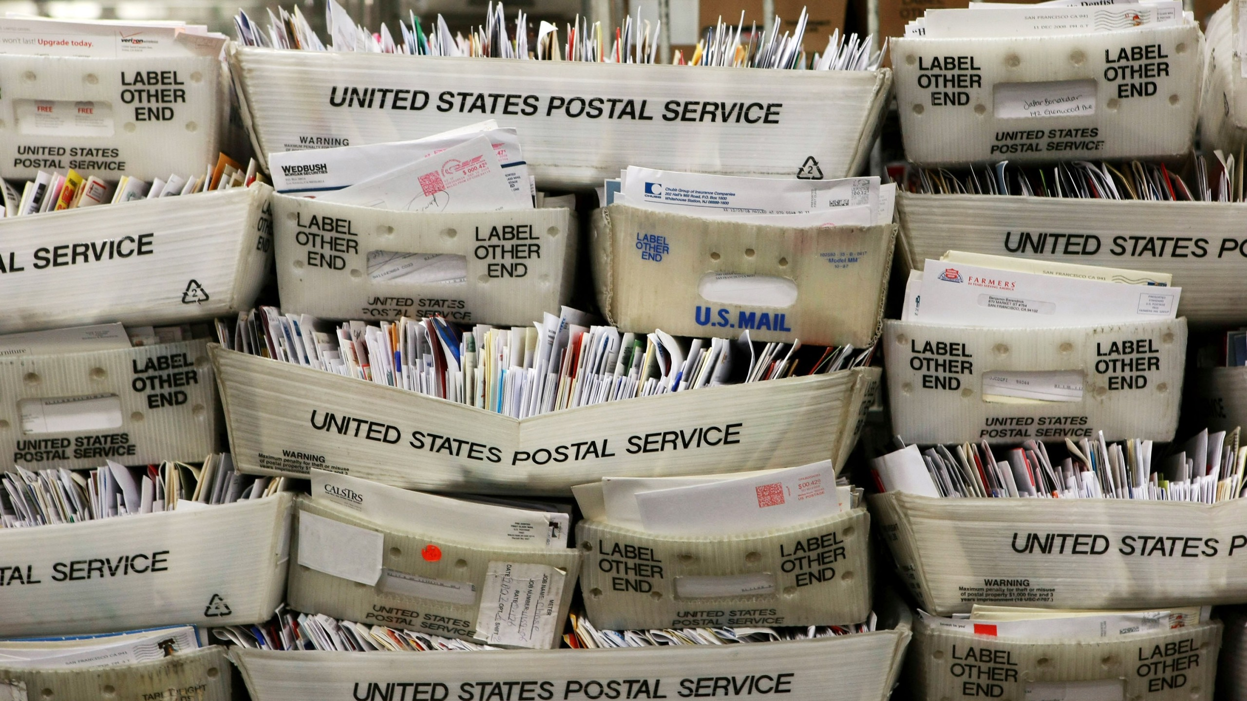 Stacks of boxes holding cards and letters are seen at the U.S. Post Office sort center December 15, 2008 in San Francisco. (Credit: Justin Sullivan/Getty Images)