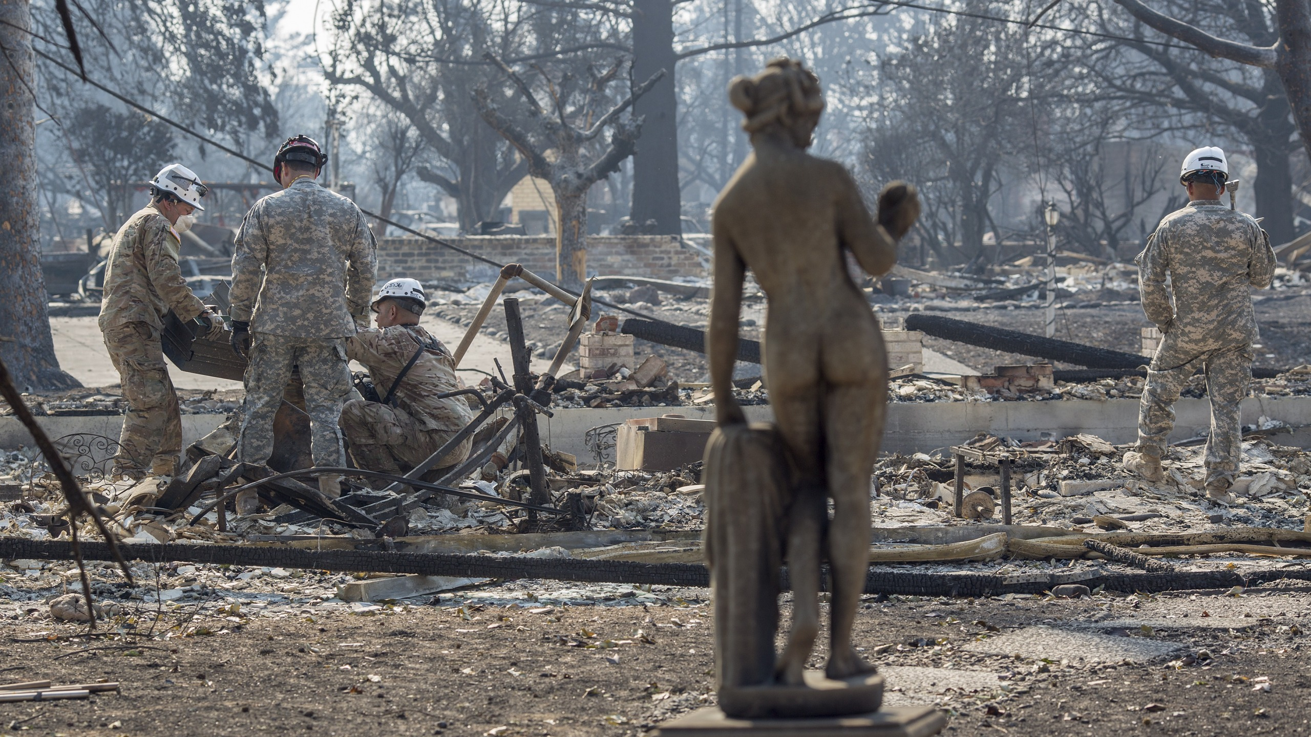 California National Guard troops search burned homes near Mark West Springs Road and Old Redwood Highway on Oct. 15, 2017 in Santa Rosa. (Credit: David McNew/Getty Images)