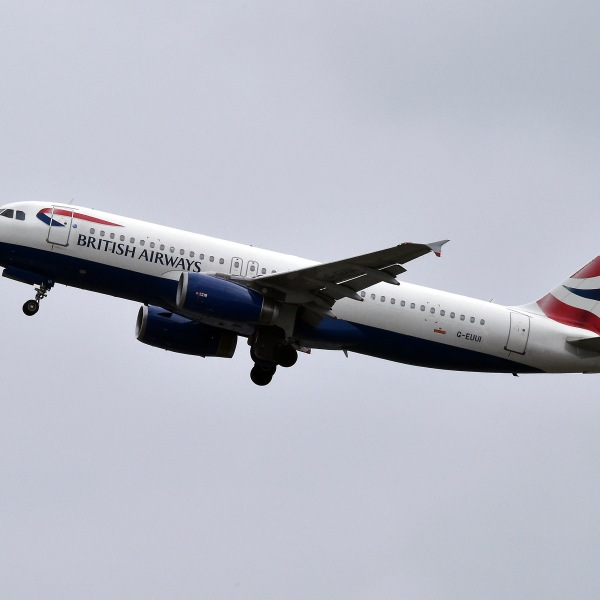 An Airbus A320 of British Airways airline flies after taking off from Toulouse on Oct. 19, 2017. (Credit: Pascal Pavani/AFP/Getty Images)