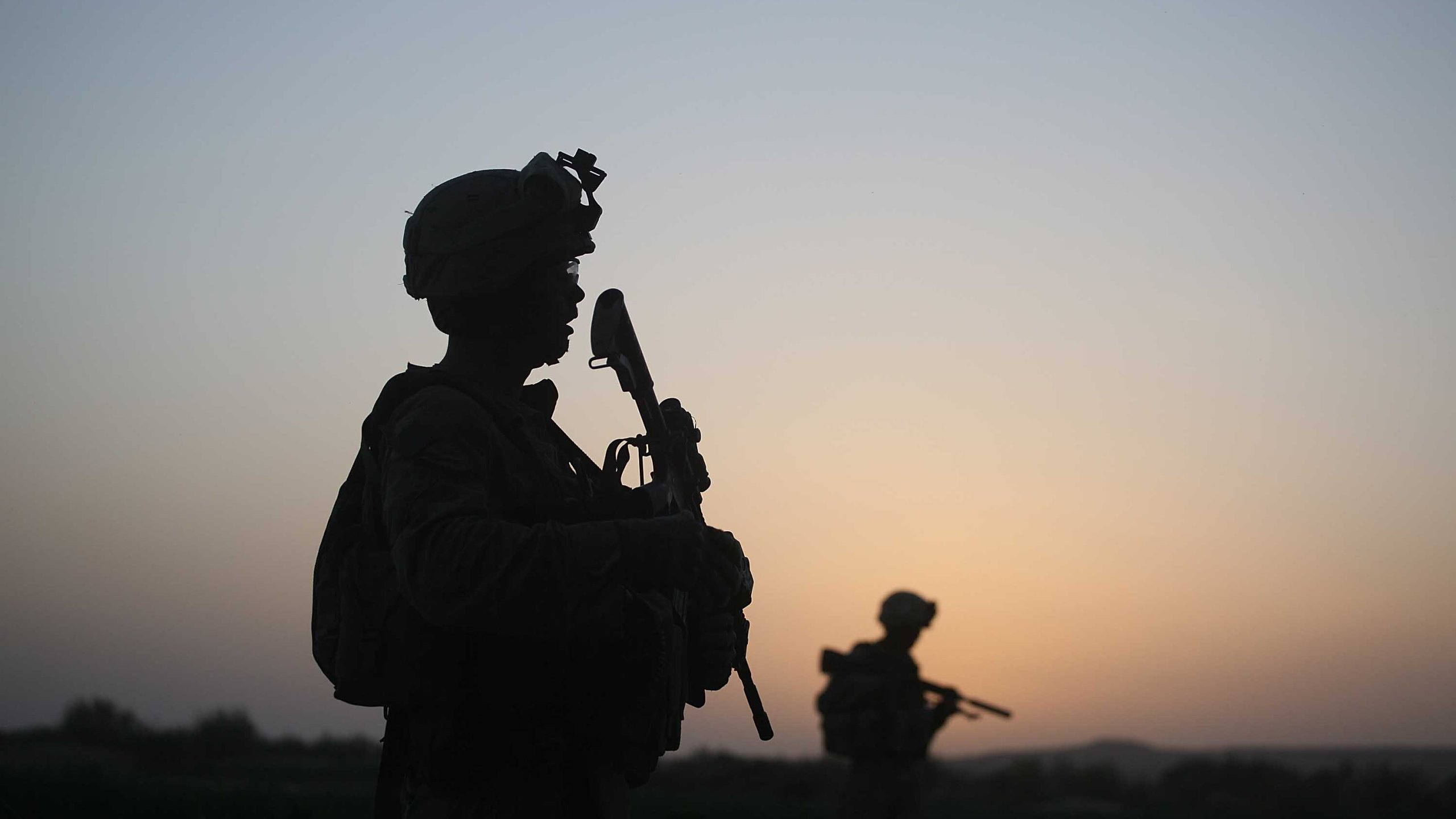 U.S. Marines with the 2nd Marine Expeditionary Brigade, RCT 2nd Battalion 8th Marines Echo Co. step off in the early morning during an operation to push out Taliban fighters on July 18, 2009 in Herati, Afghanistan . (Credit; Joe Raedle/Getty Images)