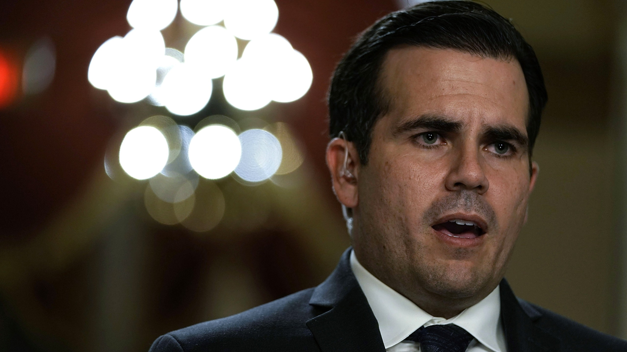 Puerto Rican Gov. Ricardo Rossello is interviewed by a TV channel after a House vote at the Capitol December 21, 2017. (Credit: Alex Wong/Getty Images)