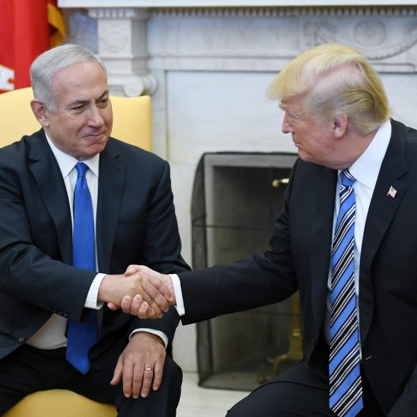 U.S. President Donald Trump shakes hands with Israel Prime Minister Benjamin Netanyahu as they meet in the Oval Office of the White House March 5, 2018, in Washington, D.C.(Credit: Olivier Douliery-Pool/Getty Images)