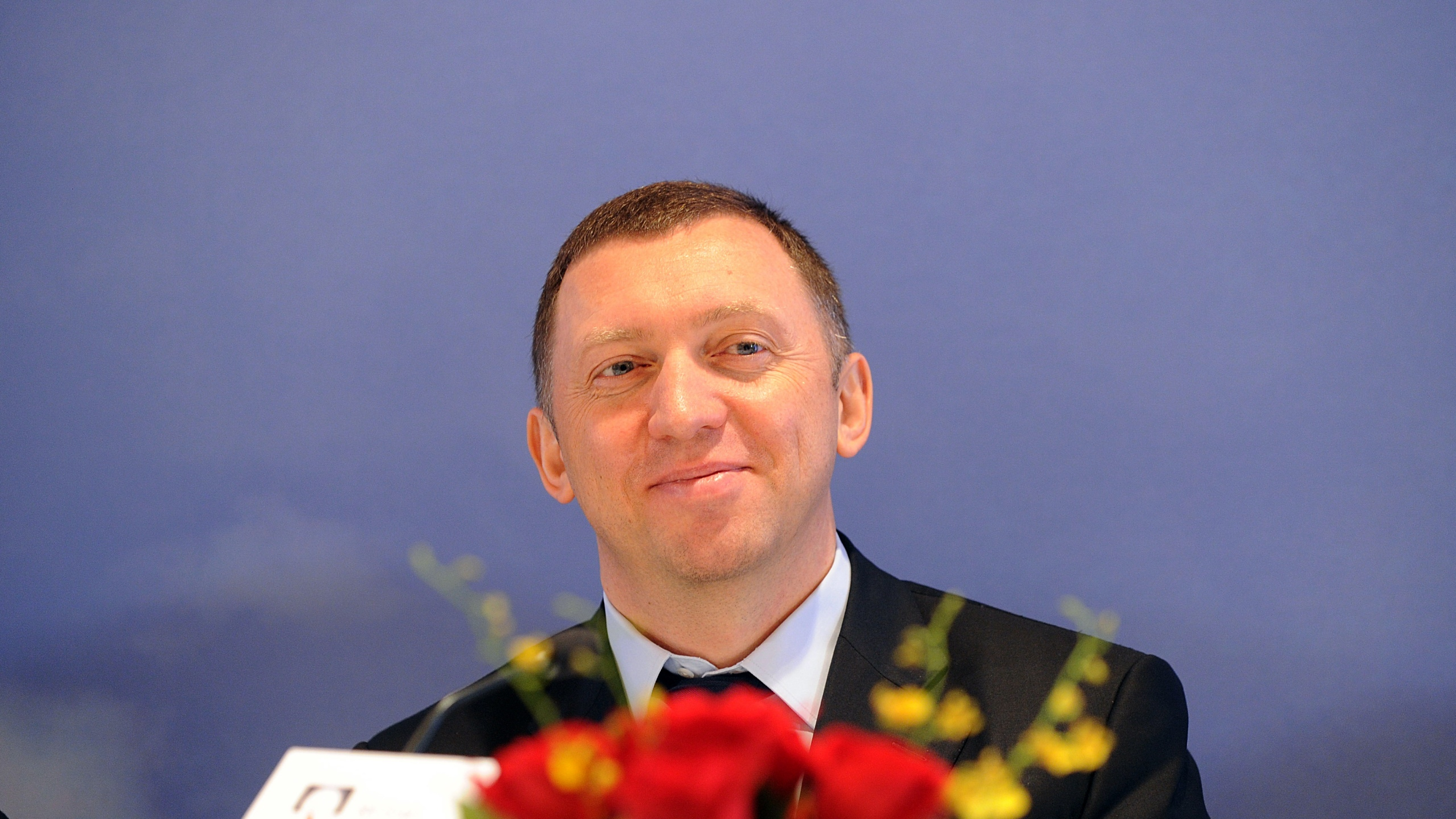 Oleg Deripaska, CEO of Russian metals giant UC Rusal, smiles during a press conference to announce the company's 2009 annual results in Hong Kong on April 12, 2009. (Credit: MIKE CLARKE/AFP/Getty Images)