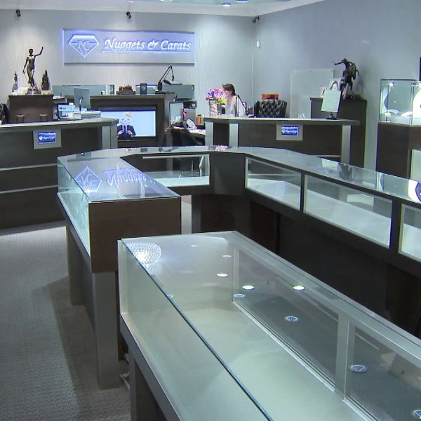 Display cases were emptied at the Nuggets and Carats jewelry store in Laguna Niguel after burglars broke in on March 23, 2019, and stole more than $1 million worth of inventory. (Credit: KTLA)