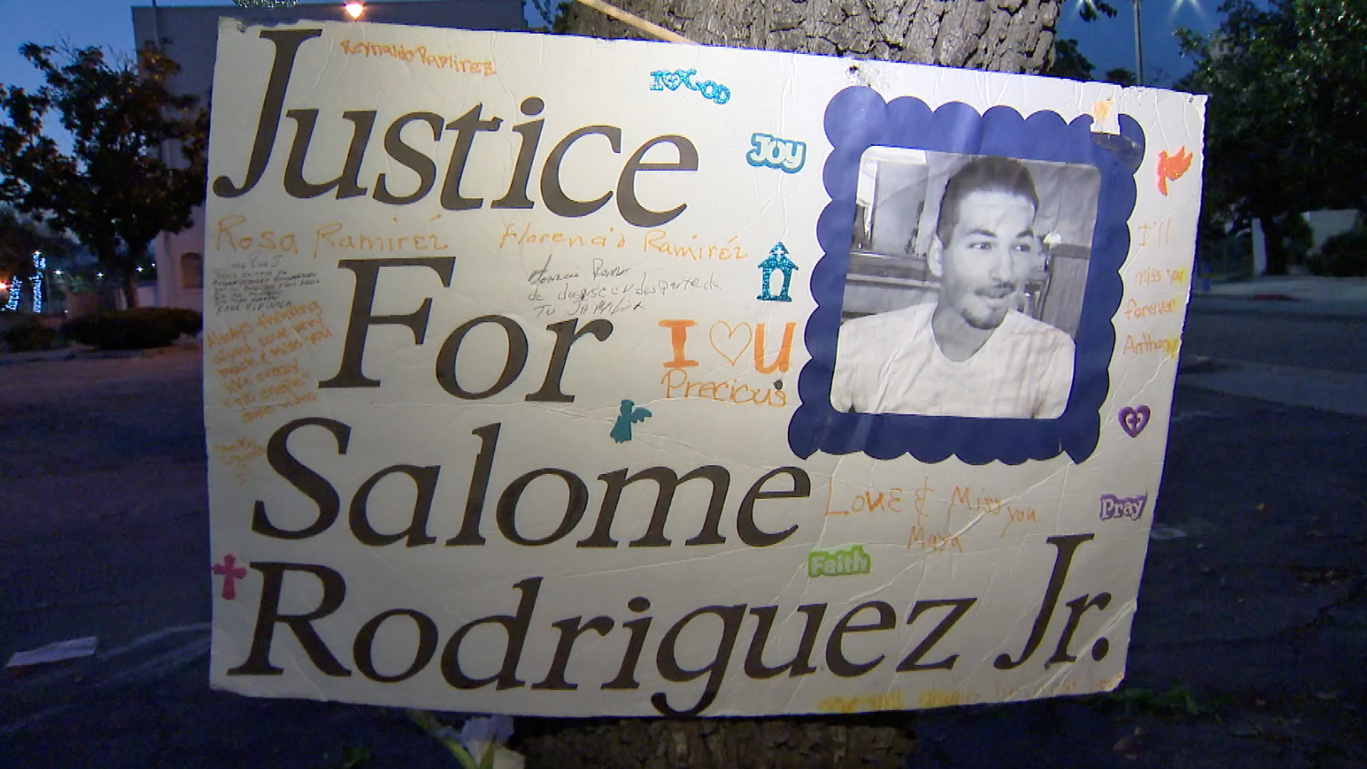 A poster for Salome Rodriguez Jr. is displayed during a vigil on March 13, 2019, the fourth anniversary of his death in Pomona. (Credit: KTLA)