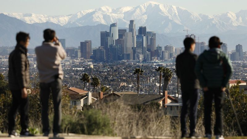 The San Gabriel Mountains dusted with snow were a rare but beautiful backdrop above downtown Los Angeles on Feb. 6. (Credit: Al Seib / Los Angeles Times)