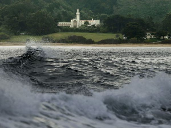 Waves break at Monastery Beach, with the Chapel of the Carmelite Monastery in the background, in Carmel in this 2013 file photo. (Credit: Mark Boster / Los Angeles Times)