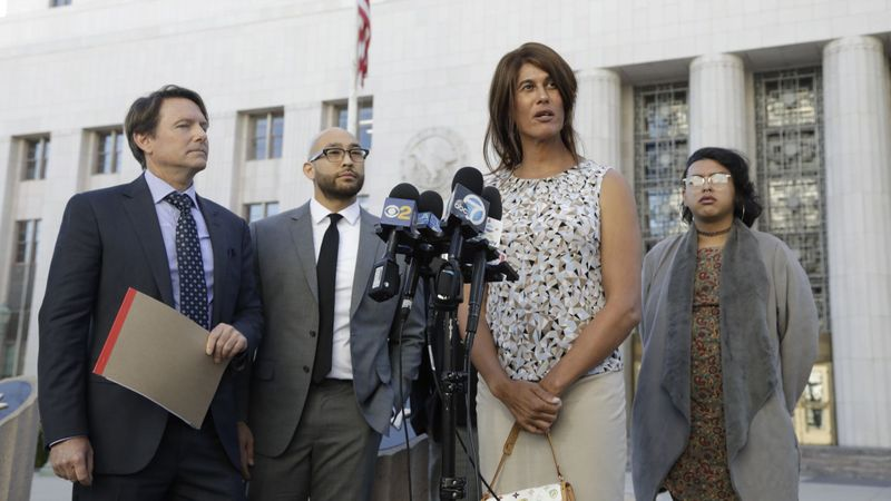 Zhoie Perez, second from right, speaks during a news conference on March 13, 2019. (Credit: Katie Falkenberg / Los Angeles Times)