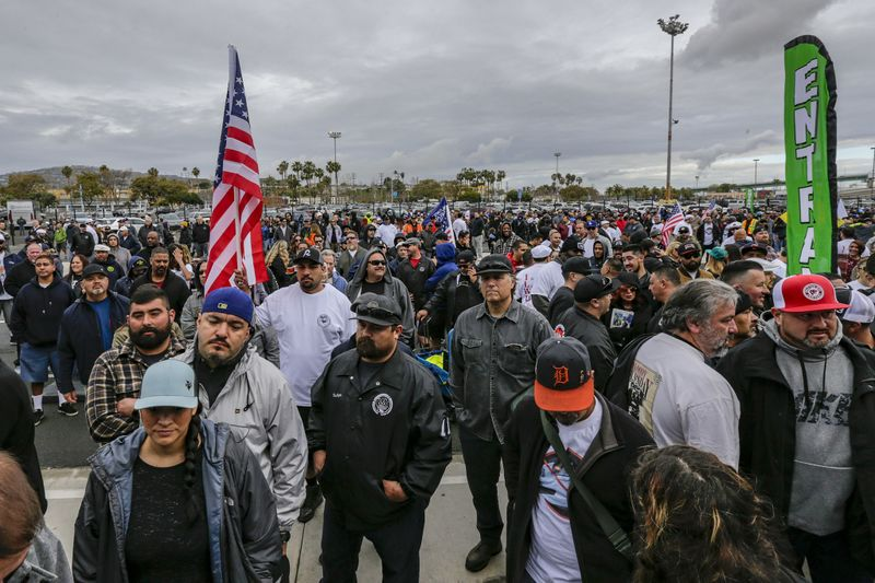Union members gather at the Port of Los Angeles on March 21, 2019, during an L.A. Harbor Commission meeting over whether to allow APM, which operates the world's biggest terminal, to use driverless electric cargo vehicles. (Credit: Irfan Khan / Los Angeles Times)