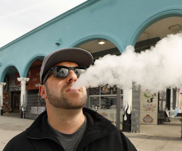 Marc Bury, visiting from Germany, vapes at the Venice Boardwalk on March 26, 2019. (Credit: Al Seib / Los Angeles Times)