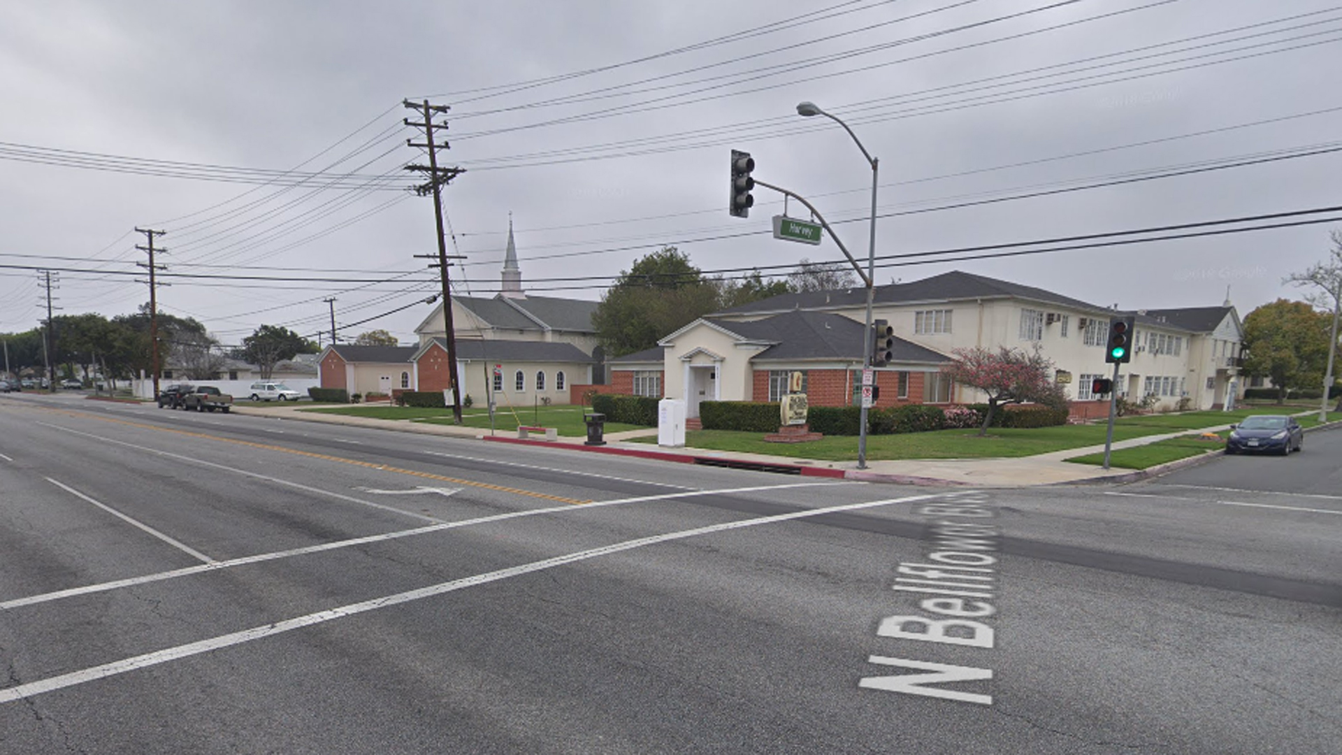 The intersection of Harvey Way and Bellflower Boulevard is shown in a Street View image from Google Maps.