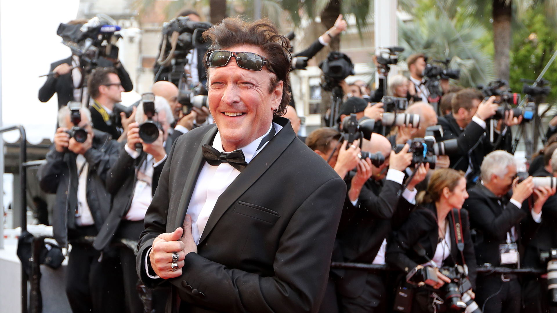 "Michael Madsen poses as he arrives on May 14, 2018 for the screening of the film ""BlacKkKlansman"" at the 71st edition of the Cannes Film Festival in Cannes, France. (Credit: VALERY HACHE/AFP/Getty Images)"
