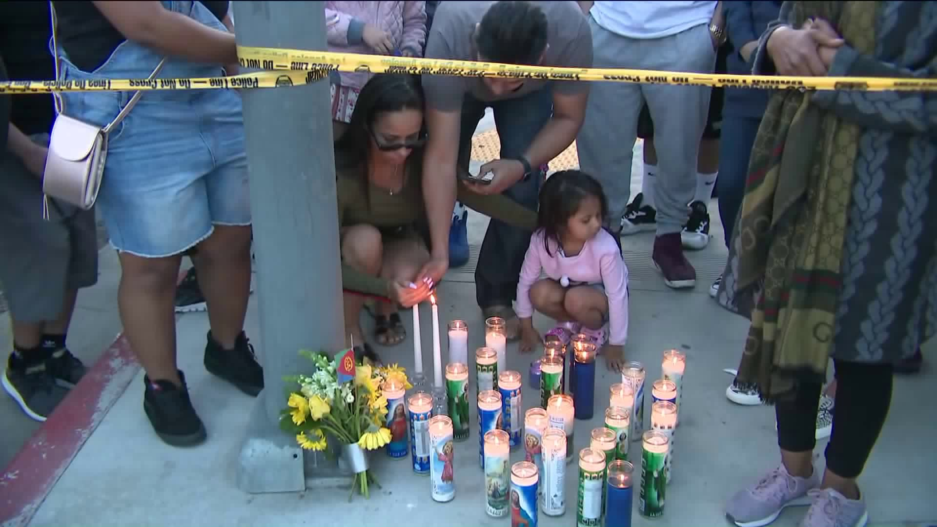 Hundreds of people gathered at the scene where rapper Nipsey Hussle was fatally shot in Hyde Park on March 31, 2019. (Credit: KTLA)