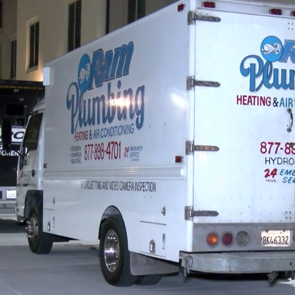 A plumbing van is seen parked alongside police investigation vehicles outside an apartment in Corona on March 18, 2019. (Credit: InlandNews)