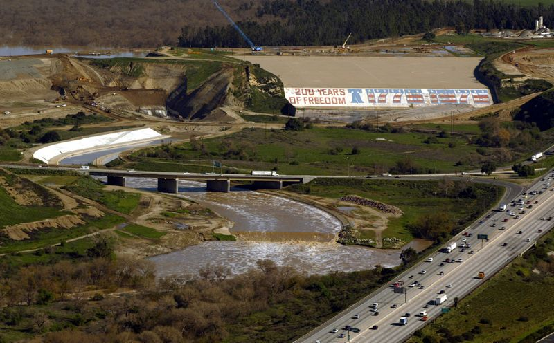 The bicentennial mural painted on the Prado Dam spillway in Corona, shown here in 2005, greets motorists entering Riverside County at the intersection of the 91 and 71 freeways. (Credit: Irfan Khan / Los Angeles Times)