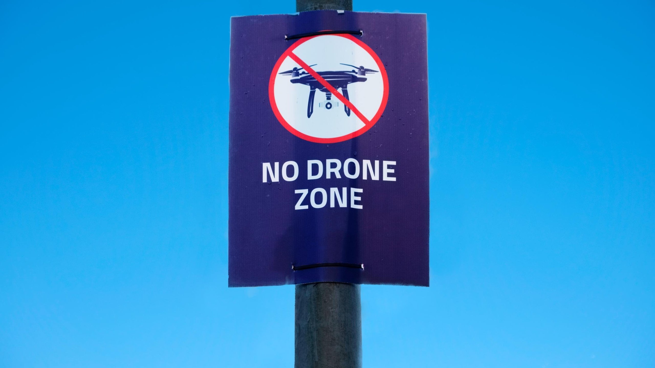"A ""no drone zone"" sign is seen at an airport in the United Kingdom in an undated photo. (Credit: Richard Johnson/Getty Images)"