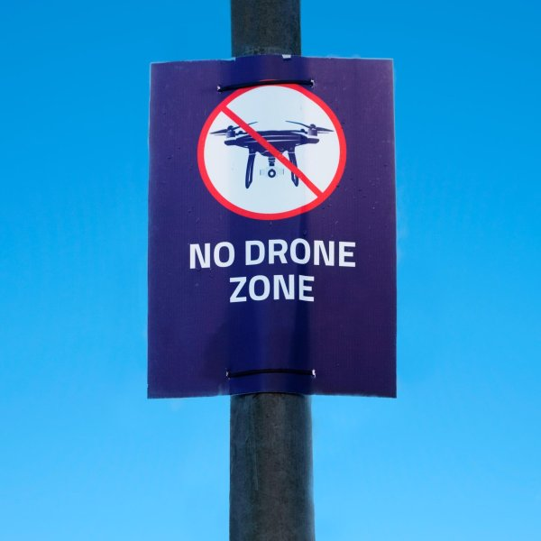 """A """"no drone zone"""" sign is seen at an airport in the United Kingdom in an undated photo. (Credit: Richard Johnson/Getty Images)"""