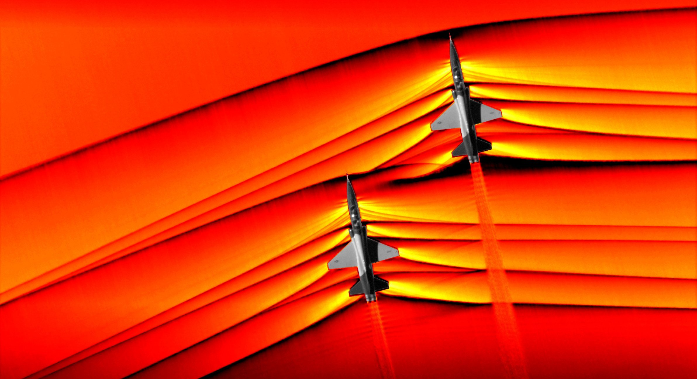 NASA captured the first ever air-to-air images of shock waves interacting from two supersonic T-38 US Air Force jets. (Credit: NASA)