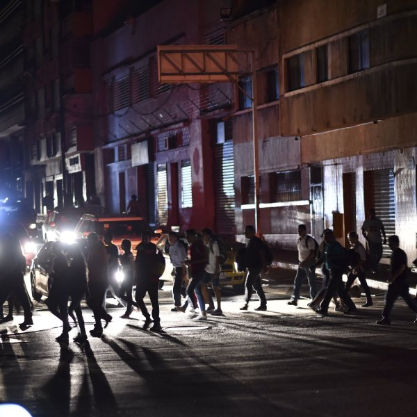 People cross a street during a power cut in Caracas, Venezuela, on March 7, 2019. (Credit: Yuri Cortez/AFP/Getty Images)