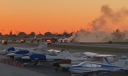 Smoke rises over the scene of a two-plane crash at the Compton/Woodley Airport on March 13, 2019. (Credit: John Medford/Facebook)
