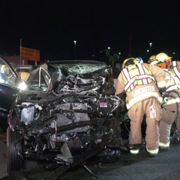 Firefighters extract a driver from a pickup truck involved in a deadly crash on the 405 Freeway in Fountain Valley on March 30, 2019. (Credit: ANG News)