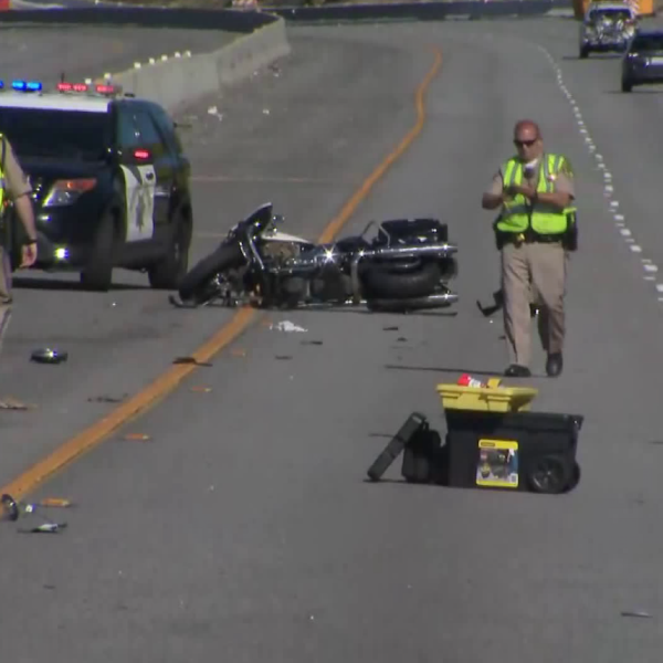A motorcycle lies on the 101 Freeway in Agoura Hills after the California Highway Patrol officer riding it was airlifted from the scene on March 31, 2019. (Credit: KTLA)