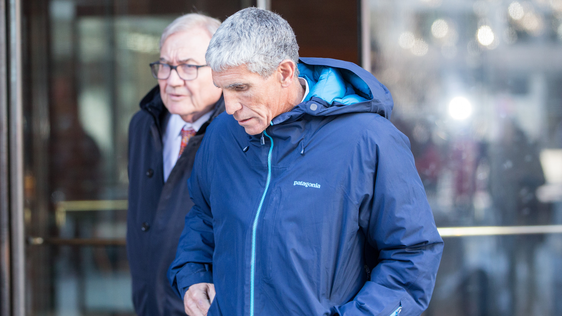 """William """"Rick"""" Singer, the Newport Beach consultant accused of leading the scheme, leaves Boston Federal Court after being charged with racketeering conspiracy, money laundering conspiracy, conspiracy to defraud the United States, and obstruction of justice on March 12, 2019, in Boston. Singer is among several charged in alleged college admissions scam. (Credit: Scott Eisen/Getty Images)"""