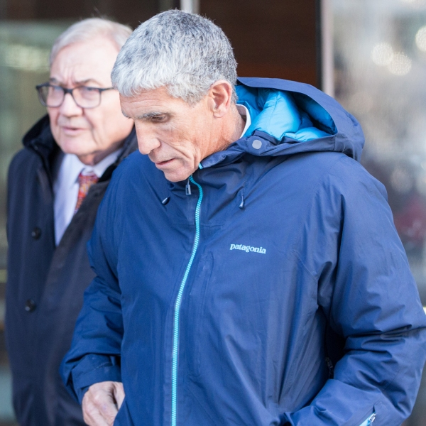 "William ""Rick"" Singer, the Newport Beach consultant accused of leading the scheme, leaves Boston Federal Court after being charged with racketeering conspiracy, money laundering conspiracy, conspiracy to defraud the United States, and obstruction of justice on March 12, 2019, in Boston. Singer is among several charged in alleged college admissions scam. (Credit: Scott Eisen/Getty Images)"