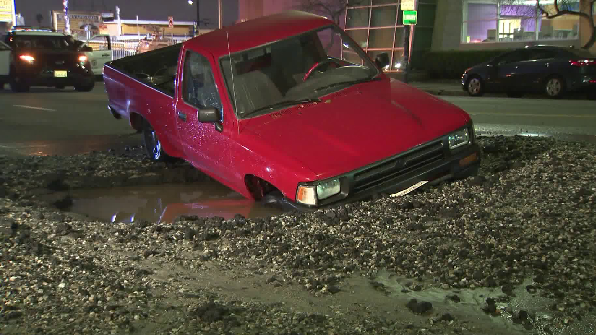 A truck became stuck in a sinkhole in South Los Angeles on March 1, 2019. (Credit: KTLA)