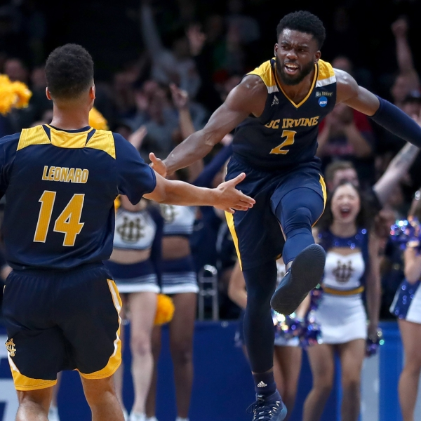 Evan Leonard #14 of the UC Irvine Anteaters celebrates a three-point shot with Max Hazzard #2 in the second half against the Kansas State Wildcats during the first round of the 2019 NCAA Men's Basketball Tournament at SAP Center on March 22, 2019, in San Jose. (Credit: Yong Teck Lim/Getty Images)
